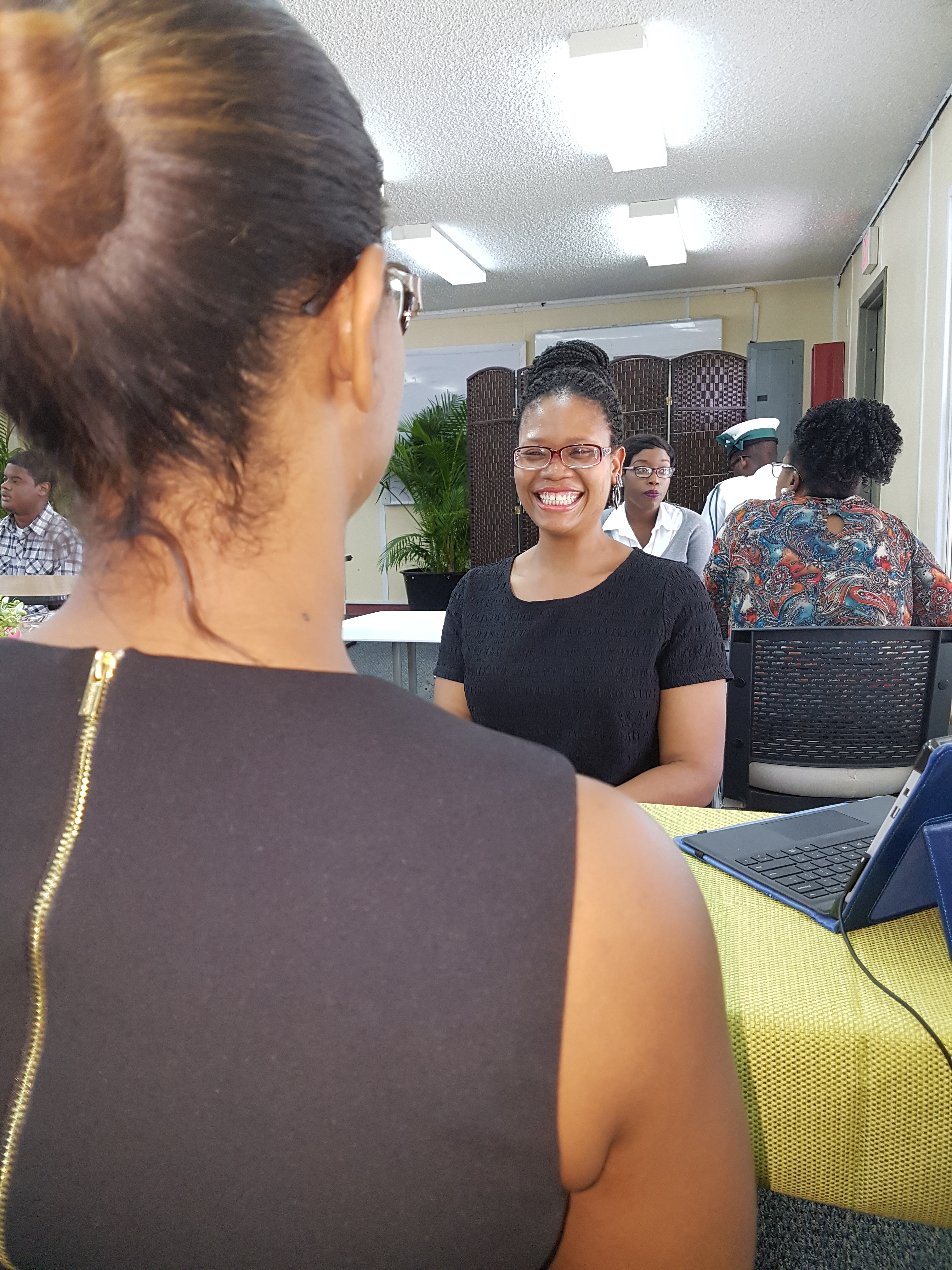 Nail Tech major, Gabrielle Tracey, beams during her interview with the Human Resources Manager of Wildflowers, Ordain Moss during BTVI's speed networking initiative.