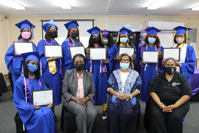 A few members of the Bahamas Technical and Vocational Institute's Class of 2021, who qualified for induction into the National Technical Honor Society (NTHS), were recently recognized. Seated left to right: NTHS member Anastasia Knowles; BTVI Dean of Academic Affairs, Dr. Pleshette McPhee; BTVI Dean of Student Affairs, Racquel Bethel and BTVI Student Counselor, Pamela McCartney. Standing left to right: NTHS members, Laverne Gardiner, Edwinique Culmer, Bianca Seymour, Geraldine Rahming, Keisha Jones, Rehema Farrington and Stefanique Russell.