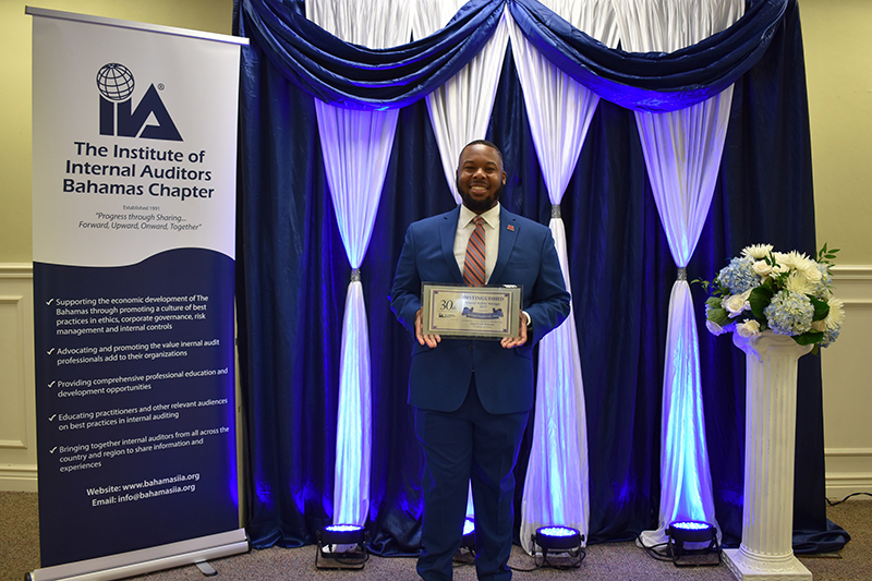 Leonardo Ferguson, Supervisor, Internal Audit, Colina Holdings Bahamas Limited proudly displays his  award for Distinguished Internal Audit Manager on the occasion of the 30th Anniversary of the Institute  of Internal Auditors Bahamas Chapter