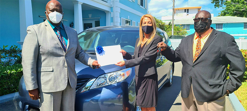 IDB COO Maria Eugenia Roca & staff officially hand over donated vehicle to PHA officials.