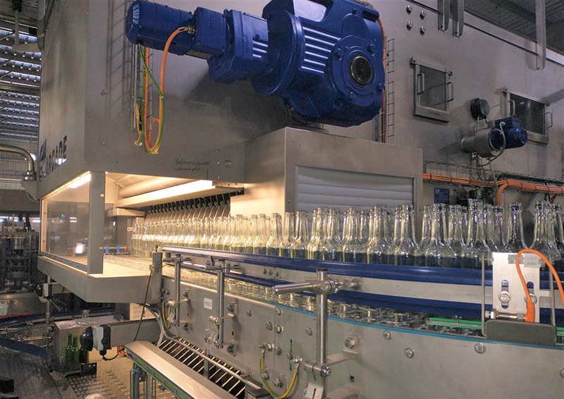 Both new and recycled bottles go through a  certified sterilization process before their journey on the bottling line.