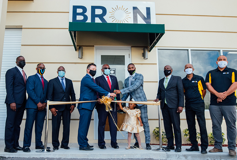 (L-R) Minister Ellsworth Johnson, Minister Iram Lewis, Minister Michael Pintard, BRON Co-founder Scott Blacquiere, Most. Hon. Prime Minister Dr. Hubert Minnis, BRON-Co Founder Carlos Palacious, his daughter Cairo Palacious,  Deputy Prime Minister Desmond Bannister, BRON Director Kevin Sweeting, and Principal Structural Engineer Davon Edgecombe cut the ribbon to officially open the BRON Business Centre.