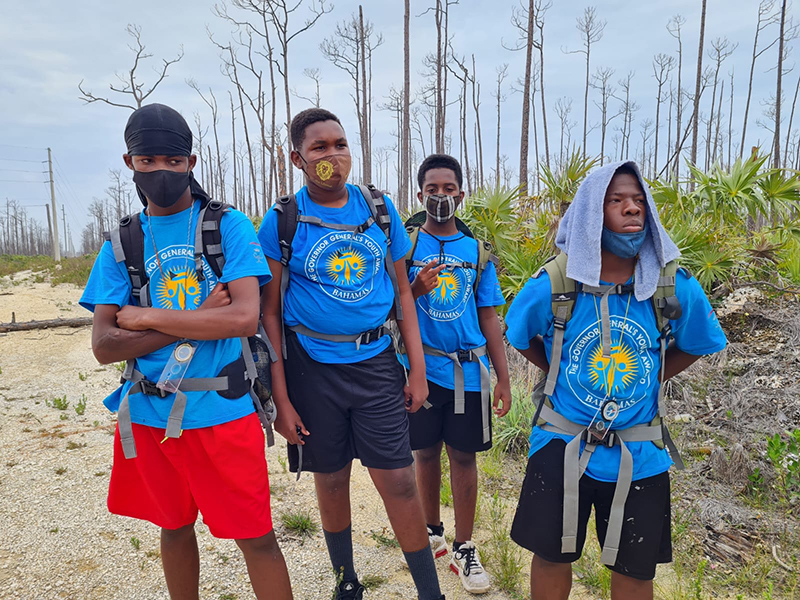 Participants on the hike were split into two groups. Over the course of the two-day/one-night expedition they became more independent, learnt survival skills and how to work together as a team. Pictured here from left to right are Kevin Jean, David Munroe, Levar Laing and Dennis Maycock. Photo courtesy of GGYA via Precision Media