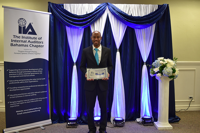 Dario Penn, Junior Internal Auditor, Colina Holdings Bahamas Limited receives an award for  Distinguished Junior Internal Auditor at an event held to mark the 30th Anniversary of the Institute  of Internal Auditors Bahamas Chapter