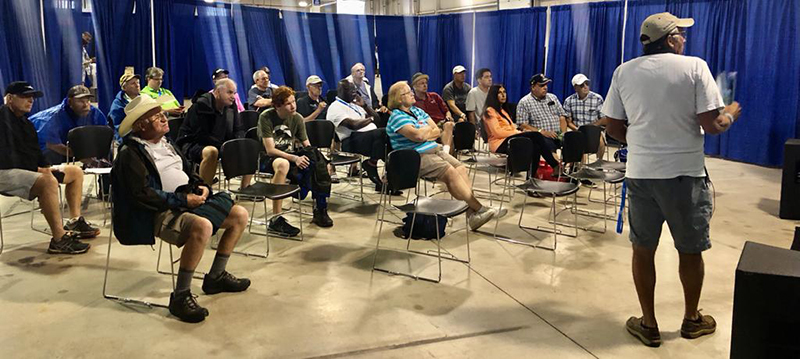 Permanent Secretary, Reginald Saunders takes time out to listen in and attend Flying to The Bahamas Seminars, conducted by Bahamas Flying Ambassador, Mike Z.  The special daily seminars are for pilots who have committed to flying their airplanes and or conducting fly outs to The Bahamas.