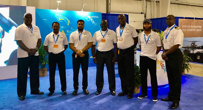 Bahamas' presence at the 2021 EAA AirVenture Oshkosh is already being felt.  Pictured centered is Mr. Reginald Saunders, Permanent Secretary, BMOTA, flanked by members of his Bahamas team including from left to right:  Deckery Johnson, BTO-Houston; Nuvolari Chotoosingh, BTO-Grand Bahama; Jonathan Lord, BTO-Plantation; Greg Rolle, Senior Director, BMOTA Verticals Department; Aram Bethell, BTO-Plantation; and Nathan Butler, Bahamas Customs Department.