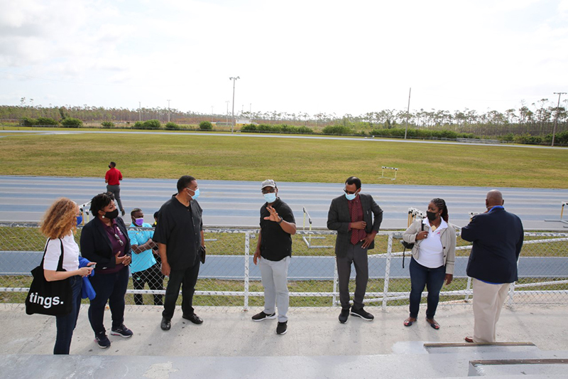 While touring the facilities that fall under the Ministry of Youth, Sports and Culture on Monday, the Minister responsible, the Hon. Iram Lewis, discusses the seating area at the Grand Bahama Sports Complex. Senior officers of that Ministry were on island for the day to tour various areas. (BIS Photo/Andrew Miller)