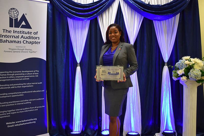 Giorgina Duncanson-Thompson, Chief Group Internal Auditor, Colina Holdings Bahamas Limited displays her Distinguished Chief Auditor Executive Award