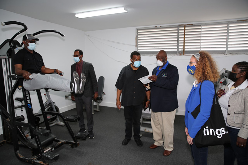 Minister of Youth, Sports and Culture, the Hon. Iram Lewis is seen (at left) trying out some of the exercise equipment at the Grand Bahama Sports Complex. The Minister hosted his senior members of staff to the island for them to see firsthand what is needed. (BIS Photo/Andrew Miller)