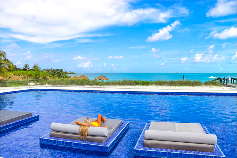 The expansive oceanfront saltwater pool at 23 North is the newest addition to Grand Isle Resort & Residences in Exuma where Bahamians are discovering the pleasure of vacationing in their own backyard, enjoying beachfront beauty and luxury at special resident rates good for a limited time.