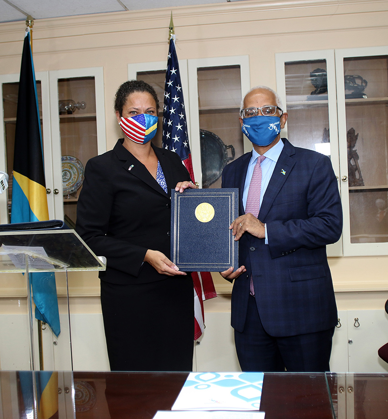 US Embassy Charge d'Affaires Usha Pitts and Minister of Tourism and Aviation the Hon. Dionisio D'Aguilar are pictured at the signing ceremony for the historic Air Navigation Services Agreement between the newly-created Bahamas Air Navigation Services Authority and the United States Federal Aviation Administration, May 5, 2021 at the Cabinet Office.