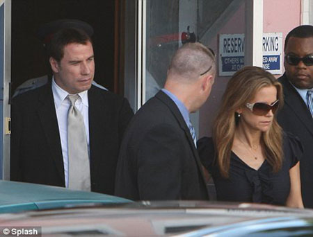 John Travolta and Kelly Preston leave the court house in Nassau, The Bahamas after John Travolta testifies in the $25 million extortion case